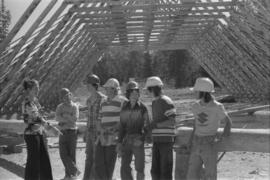 Iona Campagnolo, men, and teenagers at a construction site, possibly for a Young Canada Works pro...