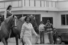 Iona Campagnolo walking in parade in Smithers in front of horses