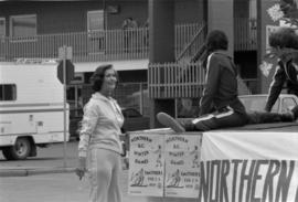 Iona Campagnolo next to parade float for the 1979 Northern BC Winter Games in Smithers