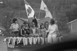 Iona Campagnolo and children riding on a truck bed in a parade in Smithers
