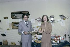 Iona Campagnolo with an opened tin of salmon and man at the opening of the Prince Rupert Fishing ...