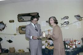 Iona Campagnolo and a man with a can of salmon at the opening of the Prince Rupert Fishing Exhibit