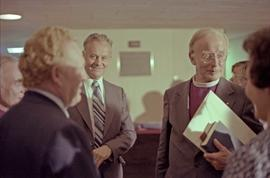 Archbishop of Canterbury Donald Coggan talks to Cyril Shelford, Bishop Hambridge, and others in T...