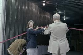 Iona Campagnolo and Cliff McGinnis cut ribbon at opening ceremony for Queen Charlotte Helicopters...