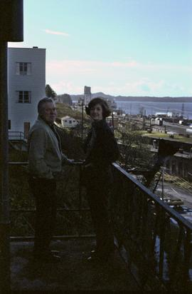 Iona Campagnolo and Joe Scott on balcony with view of Prince Rupert