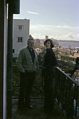 Iona Campagnolo and Joe Scott on balcony with view of Prince Rupert and ocean