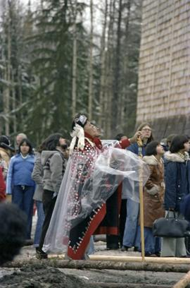 First Nations people wearing button blanket at raising of Unity Totem Pole in New Aiyansh