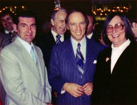 Prime Minister Pierre Trudeau, Evelyn Basso and man with crowd at Northern BC Winter Games event ...