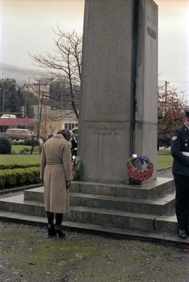 Iona Campagnolo with bowed head at cenotaph monument at Remembrance Day ceremony