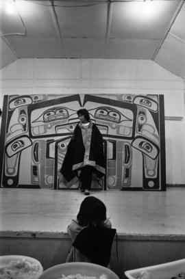 Glen Vowell First Nations child watching performance on stage at potluck