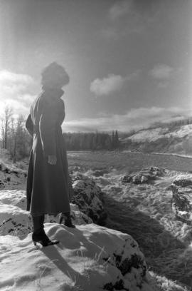 Iona Campagnolo with flooded Bulkley River near Moricetown in background