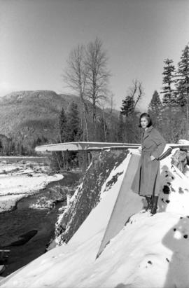 Iona Campagnolo on river bank by damaged bridge near Moricetown
