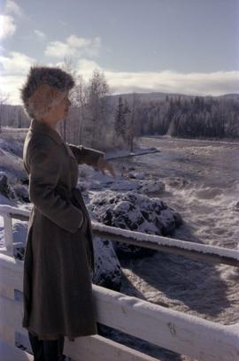 Iona Campagnolo surveying flooded Bulkley River from bridge near Moricetown