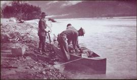 Taku River Survey - Men Loading Canoe