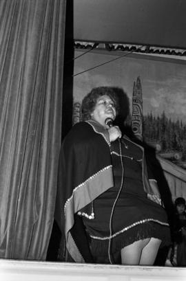 Woman wearing button blanket in Skidegate, possibly Ada Yovanovich or Blanche MacDonald