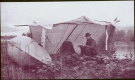 Taku River Survey - Man sitting under tent structure