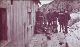 Taku River Survey - Men at Unknown Building