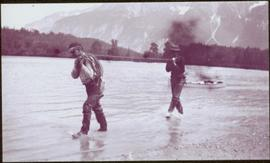 Taku River Survey - Two Men Walking in Kopoka River