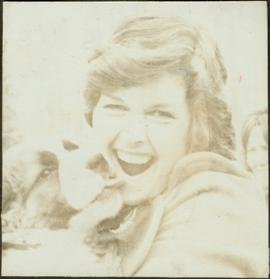 Iona Campagnolo being kissed by a twelve week St. Bernard puppy at the Kispiox Rodeo