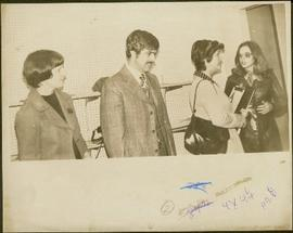 Unidentified man and woman stand next to Iona Campagnolo and Teresa Wright