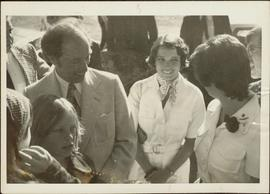 Pierre Trudeau and Iona Campagnolo smile back at Margaret Trudeau