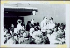 Pierre Trudeau and Iona Campagnolo speak to crowd together at microphone