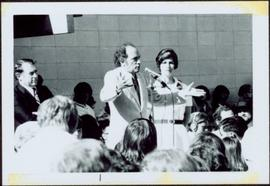 Pierre Trudeau speaks to crowd, Iona Campagnolo beside him