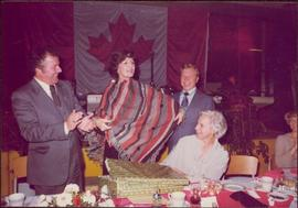 M.P. Iona Campagnolo receives gift at a reception in Jeanne Sauvé's riding, Ahuntsic, late 1974