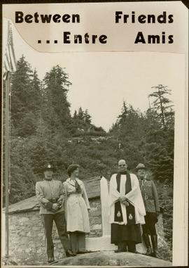 Two RCMP officers, Iona Campagnolo, and a priest stand at the border of Canada and the United States of America, Hyder and Stewart, ca. 1976
