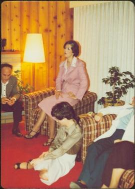 'Living Room Speech,' Terrace, 1975 - Several unidentified people sit listening to Iona Campagnolo speak
