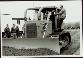 Two unidentified men operating a bulldozer at the sodturning ceremony for the opening of the Prin...