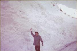Unidentified Woman standing near Snow along Highway 16 and the Skeena, ca. 1976