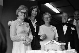 Group photo with Iona Campagnolo and decorative cake at grand opening of Grand Lodge for Independ...