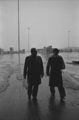 Otto Lang and man walking on Fairview Cargo Terminal in Prince Rupert