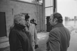 Otto Lang speaking with two unknown men during his visit to Fairview Cargo Terminal in Prince Rupert