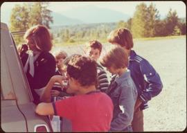 Minister Iona Campagnolo signing autographs for group of six unidentified children from the side ...