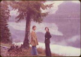Minister Iona Campagnolo and Peter Jones overlooking a lake on Highway 37, 1977