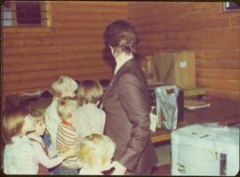 Iona Campagnolo with children during tour to bring television access from Yukon to Atlin, 1977