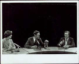 Close View of Minister Iona Campagnolo, Jean Chretien, and Hugh Faulkner seated at a media 'Round Table,' 1977