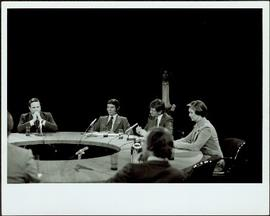 Minister Iona Campagnolo and Hugh Faulkner seated with others at a media 'Round Table,' 1977