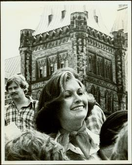 Close View of Minister Iona Campagnolo standing in group with Parliament buildings behind her, Ot...