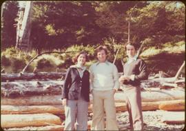 Minister Iona Campagnolo poses in front of beached driftwood with Peter Jones and an unidentified...