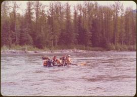 Distance shot of a group (none of whom is identifiable) river rafting, summer 1977