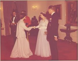 Minister Iona Campagnolo shaking hands with Her Majesty Queen Elizabeth II at a State Dinner, Rideau Hall, Ottawa, ON