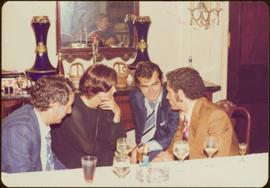 Ministry of Sport Tour - Minister Iona Campagnolo consults with group of four men about Che Gueva...