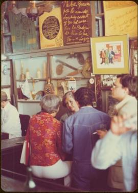 Ministry of Sport Tour - Minister Iona Campagnolo speaks to unidentified woman and man in La Bodeguita, Havana, Cuba