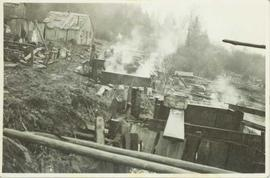 Eulachon boiling tanks on the river's edge