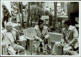 Johnny Esau, Iona Campagnolo, and George Gross sit around patio table in Vienna, European Sports ...