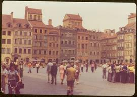 Iona Campagnolo walking into Old Town Market Square, Warsaw, Poland -