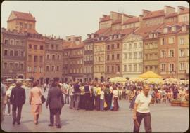 Iona Campagnolo walking at Old Town Market Square, Warsaw, Poland